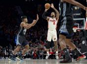 Portland Trail Blazers guard Gary Trent Jr. shoots over Golden State Warriors guard Jacob Evans during the first half of an NBA basketball game in Portland, Ore., Wednesday, Dec. 18, 2019. (AP Photo/Craig Mitchelldyer)