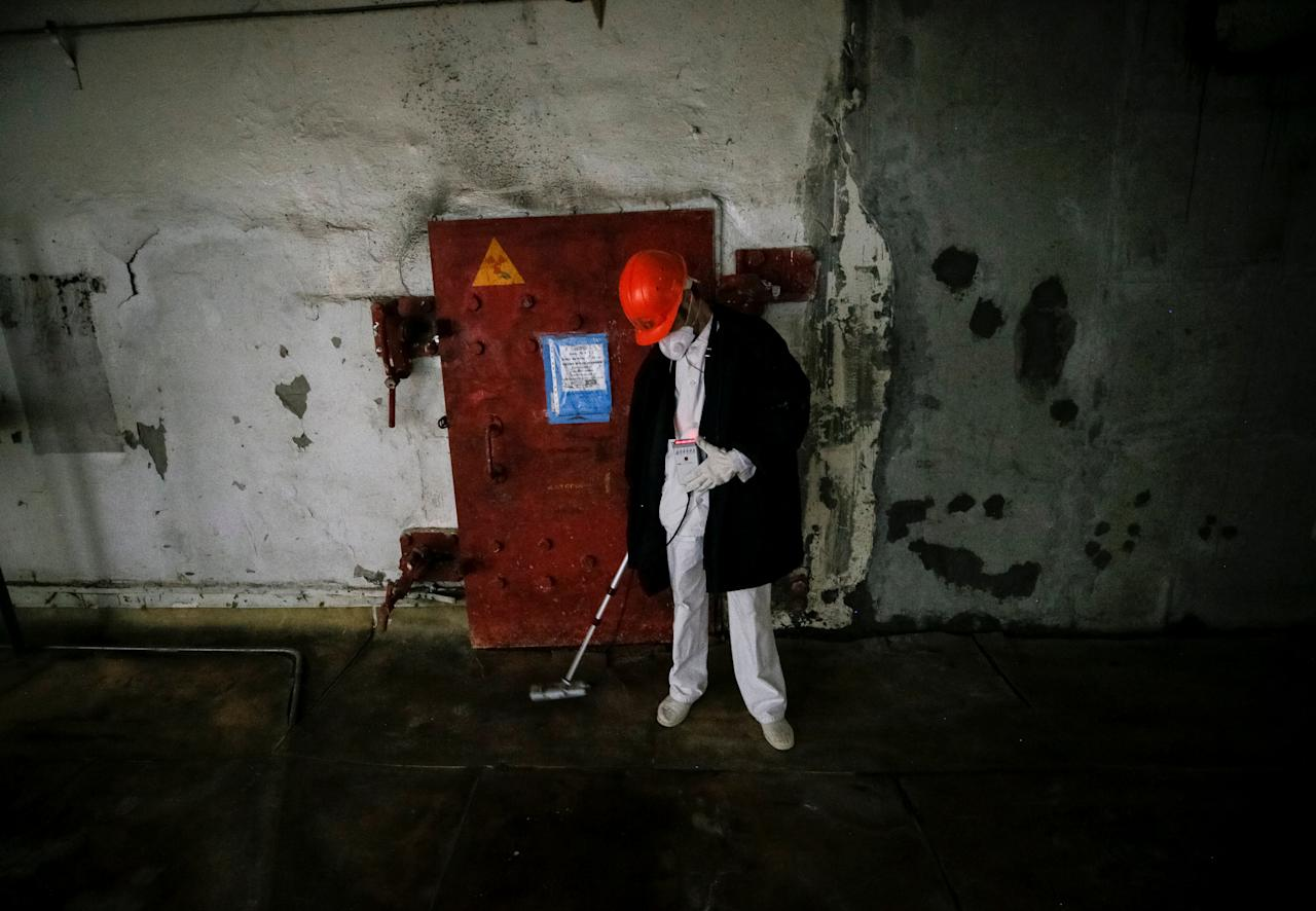 <p>An employee measures the radiation level near a damaged fourth reactor at the Chernobyl nuclear power plant in Chernobyl, Ukraine, April 20, 2018. (Photo: Gleb Garanich/Reuters) </p>