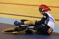 FALLING FOR GOLD: Britain's Philip Hindes sits on the ground as he waits for assistance after falling during their track cycling men's team sprint qualifying heats at the Velodrome during the London 2012 Olympic Games August 2, 2012. The officials had to assist Hindes as his left foot remained clipped in after the fall.