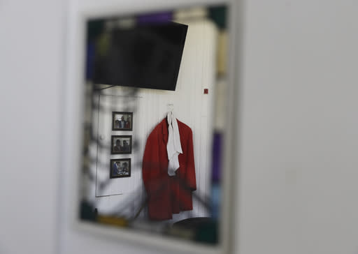 A buglers red coat is reflected into a mirror inside of the Pagoda at Churchill Downs, Wednesday, April 22, 2020, in Louisville, Ky. (AP Photo/Darron Cummings)