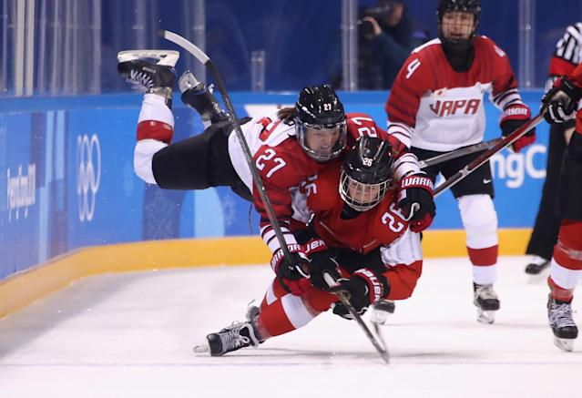 <p>Shoko Ono #27 of Japan falls on top of Dominique Ruegg #26 of Switzerland in the second period during the Women's Ice Hockey Preliminary Round – Group B game on day three of the PyeongChang 2018 Winter Olympic Games at Kwandong Hockey Centre on February 12, 2018 in Gangneung, South Korea. (Photo by Bruce Bennett/Getty Images) </p>