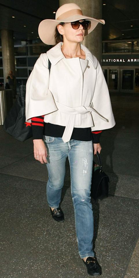 """<p>The former teen star took her style know-how to the skies on Friday, arriving at LAX in a pair of light-wash ripped jeans, an off-white jacket, floppy beige sun hat, Gucci loafers ($630; <a rel=""""nofollow"""" href=""""http://click.linksynergy.com/fs-bin/click?id=93xLBvPhAeE&subid=0&offerid=365991.1&type=10&tmpid=2174&RD_PARM1=http%3A%2F%2Fwww.&RD_PARM2=saksfifthavenue.com%2Fmain%2FProductDetail.jsp%3F&RD_PARM3=PRODUCT%253C%253Eprd_id%3D845524446893993%2526site_refer%3DAFF001%2526mid%3D13816%2526siteID%3DJ84DHJLQkR4-Fm2Sgvon70Q302V3h4STPQ%2526LSoid%3D462170%2526LSlinkid%3D15%2526LScreativeid%3D400088506740&u1=ISKatieHolmesAirportGucciIJFeb"""">saksfifthavenue.com</a>), and a Gucci handbag ($2,890; <a rel=""""nofollow"""" href=""""http://click.linksynergy.com/fs-bin/click?id=93xLBvPhAeE&subid=0&offerid=254155.1&type=10&tmpid=2911&RD_PARM1=https%3A%2F%2Fwww.net-a-porter.com%2Fus%2Fen%2Fproduct%2F802619%3F&RD_PARM2=cm_mmc%3DLinkshareUS-_-J84DHJLQkR4-_-Custom-_-LinkBuilder%2526siteID%3DJ84DHJLQkR4-oYgrJ3YXfoLvZcL.LG.pLg%2526ShopStyle%2B%2528POPSUGAR%2529%3DShopStyle%2B%2528POPSUGAR%2529&u1=ISKatieHolmesAirportIJFeb"""">net-a-porter.com</a>). </p>"""