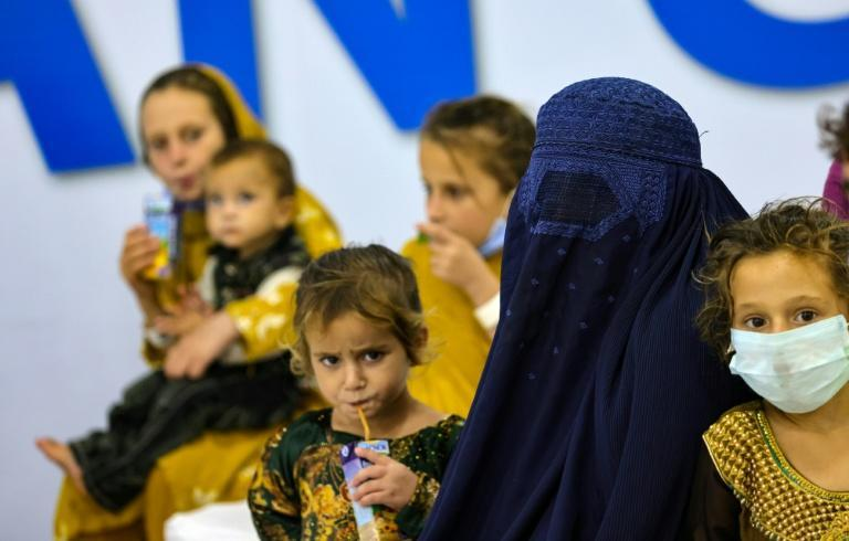 Refugees who fled Afghanistan after the Taliban takeover gather at International Humanitarian City in the Emirati capital Abu Dhabi, as they wait to be transferred to another destination (AFP/Giuseppe CACACE)