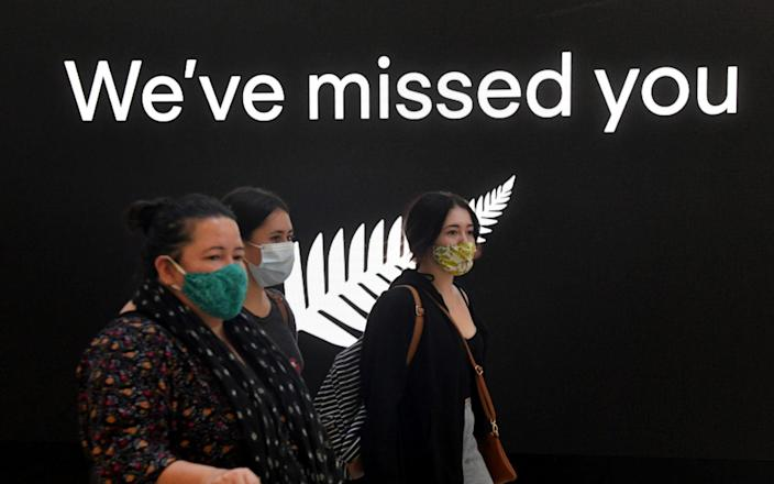 New Zealand travellers arrive at Sydney International Airport, as quarantine-free travel between Australia and New Zealand begins - Reuters