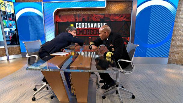 """PHOTO: Surgeon General Jerome Adams does and elbow bump with ABC News Chief Anchor George Stephanopoulos on """"GMA"""" before speaking about the latest coronavirus testing from the CDC, March 10, 2020. (GMA )"""