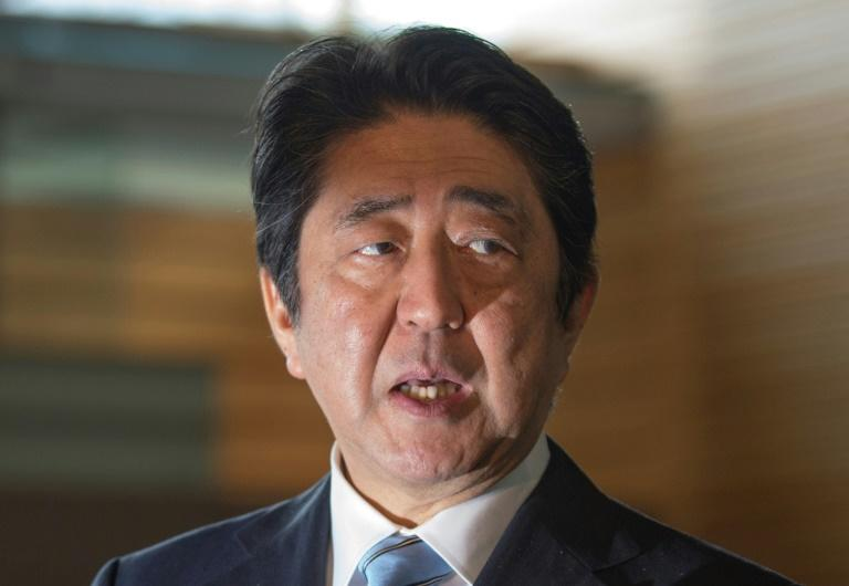 Japan's Prime Minister Shinzo Abe speaks to reporters at his official residence in Tokyo on April 5, 2017, after North Korea launched a ballistic missile into the Sea of Japan