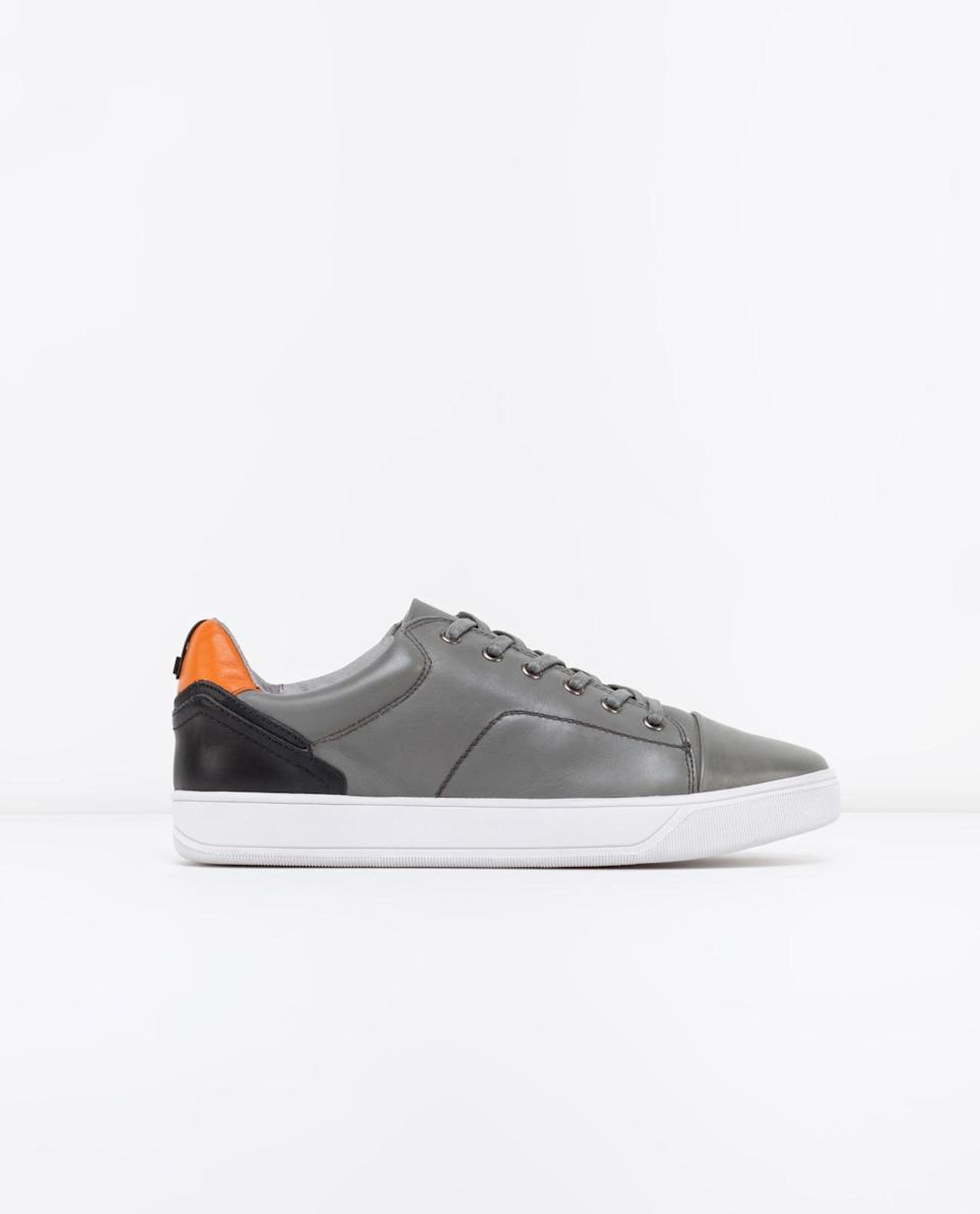<p>Give his classic sneakers an edge by opting for a pair in slick, grey leather. <i>($195 via Rudsak)</i></p>