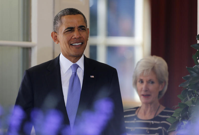 U.S. President Barack Obama walks out to deliver remarks alongside Human Services Secretary Kathleen Sebelius (R) and other Americans the White House says will benefit from the opening of health insurance marketplaces under the Affordable Care Act, in the Rose Garden of the White House in Washington, October 1, 2013. The U.S. government began a partial shutdown on Tuesday for the first time in 17 years, potentially putting up to 1 million workers on unpaid leave, closing national parks and stalling medical research projects. October 1, 2013. REUTERS/Larry Downing (UNITED STATES - Tags: POLITICS BUSINESS HEALTH)