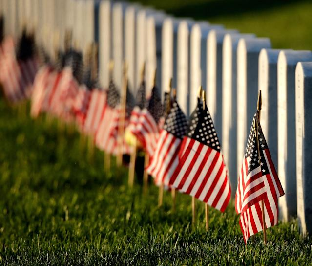 <p>Flags mark graves at Leavenworth National Cemetery on May 28, 2017, in Leavenworth, Kan. (Photo: Charlie Riedel/AP) </p>