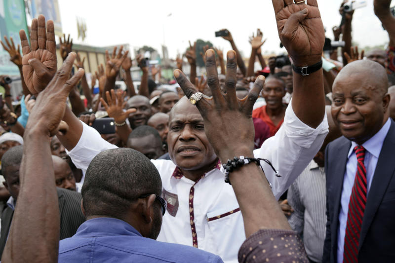 "Spurned Congo opposition candidate Martin Fayulu greets supporters as he arrives at a rally in Kinshasha, Congo, Friday, Jan. 11, 2019. Hundreds gathered to denounce what they called ""the people's stolen victory"" in the presidential election. (AP Photo/Jerome Delay)"