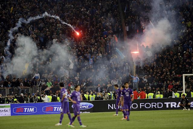 Napoli's fans throw flares during the Italian Cup final match between Fiorentina and Napoli in Rome's Olympic stadium Saturday, May 3, 2014. (AP Photo/Gregorio Borgia)