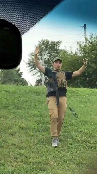 PHOTO: Dmitriy Andreychenko walks downhill with a gun sling and hands in the air before he is apprehended by police near a Walmart in Springfield, Missouri, August 8, 2019, in this still image from video obtained via social media. (Julie Belew via Reuters)