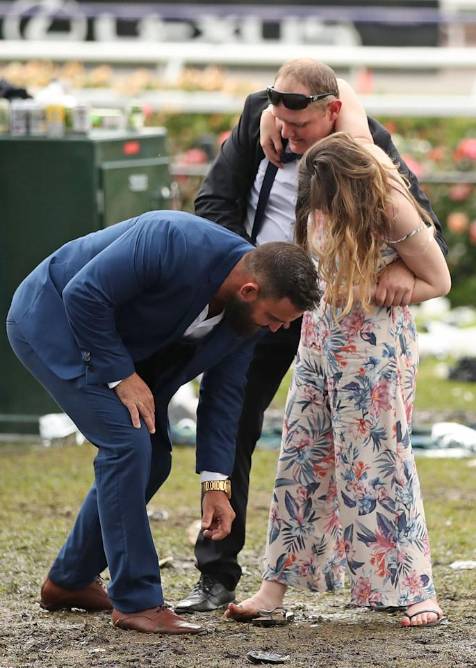 <p>Muddy grounds, soggy clothes and missing shoes didn't stop anyone from going hard on Melbourne Cup day. </p>