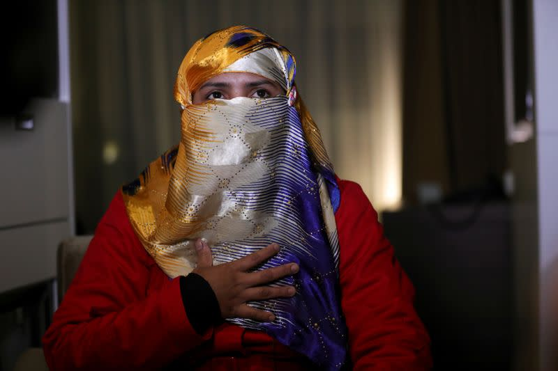 Hasina Begum, a survivor of ethnic-based violence against the Rohingya minority in Myanmar, gestures as she speaks during an interview at the Crowne Plaza Hotel in The Hague