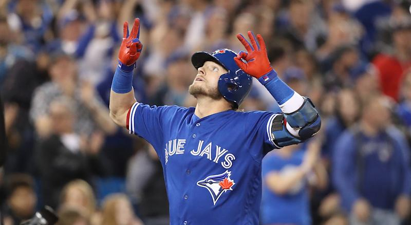 """Flashing the """"six"""" became Josh Donaldson's signature home run celebration while playing for the Blue Jays. (Photo by Tom Szczerbowski/Getty Images)"""