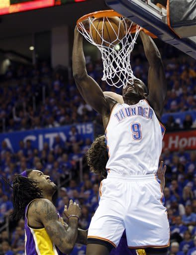 Oklahoma City Thunder forward Serge Ibaka (9) dunks in front of Los Angeles Lakers center Jordan Hill, left, and forward Pau Gasol, rear, in the first quarter of Game 5 in their NBA basketball Western Conference semifinal playoff series, Monday, May 21, 2012, in Oklahoma City. (AP Photo/Sue Ogrocki)