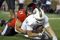 Texas Tech's Jacob Morgenstern (24) sacks Florida International's Max Bortenschlager (12) during the second half of an NCAA college football game on Saturday, Sept. 18, 2021, in Lubbock, Texas. (AP Photo/Brad Tollefson)