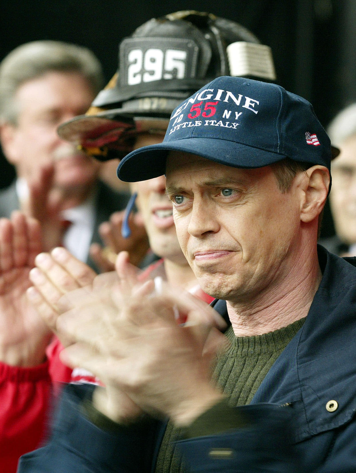 Actor Steve Buscemi applauds at a protest staged by firefighters in New York, October 11, 2002. The New York Firefighter Rally, organized by the Uniformed Firefighters Association, was held to protest current wages. The union rejected a proposal on October 10 to increase pay by 11.5 percent over 30 months. The president of the 9,000-member union said the members have been working without a contract for 29 months and deserve a larger raise. Buscemi is a former fireman. REUTERS/Shannon Stapleton  PM