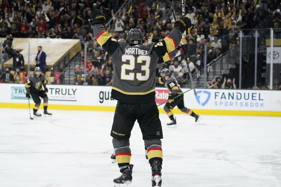 Vegas Golden Knights defenseman Alec Martinez (23) celebrates after scoring against the Montreal Canadiens during the second period in Game 1 of an NHL hockey Stanley Cup semifinal playoff series Monday, June 14, 2021, in Las Vegas. (AP Photo/John Locher)