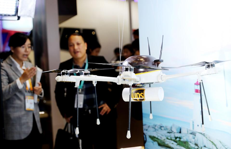 SHANGHAI, Nov. 8, 2018 -- A staff member of UPS introduces drone delivery at the Trade in Services area of the first China International Import Expo in Shanghai, east China, Nov. 8, 2018.  (Xinhua/Fang Zhe) (Xinhua/Fang Zhe via Getty Images)