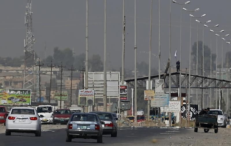 Islamic State militants man a checkpoint in Iraq's second city of Mosul (AFP Photo/Karim Sahib)