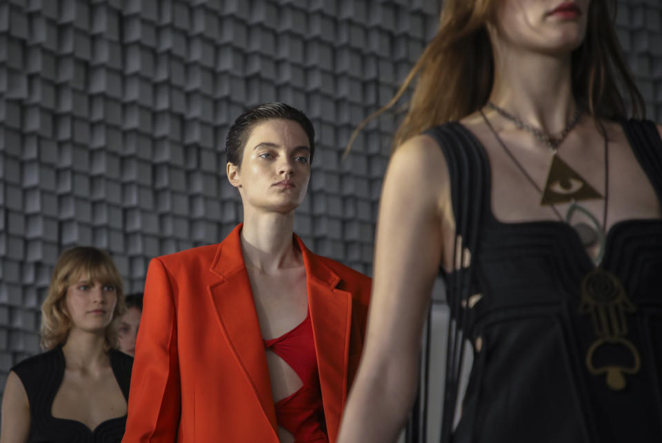 Models wear creations for the Stella McCartney Spring-Summer 2022 ready-to-wear fashion show presented in Paris, Monday, Oct. 4, 2021. (Photo by Vianney Le Caer/Invision/AP)