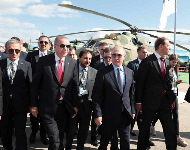 The presidents, wearing sunglasses, met on the sidelines of the MAKS international air show on the outskirts of Moscow (AFP Photo/Handout)