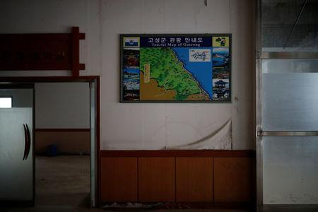 A tourist map of Goseong hangs on a wall at the abandoned Alps Ski Resort located near the demilitarised zone separating the two Koreas in Goseong, South Korea, January 16, 2018. REUTERS/Kim Hong-Ji