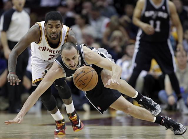 Cleveland Cavaliers' Kyrie Irving, left, and San Antonio Spurs' Manu Ginobili chase down a loose ball during the first quarter of an NBA basketball game Tuesday, March 4, 2014, in Cleveland. (AP Photo/Mark Duncan)