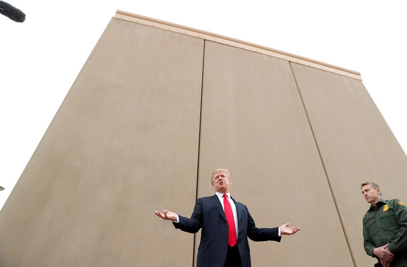 President Donald Trump speaks at an installation of U.S.-Mexico border wall prototypes near the Otay Mesa Port of Entry in San Diego on Tuesday. (Kevin Lamarque / Reuters)
