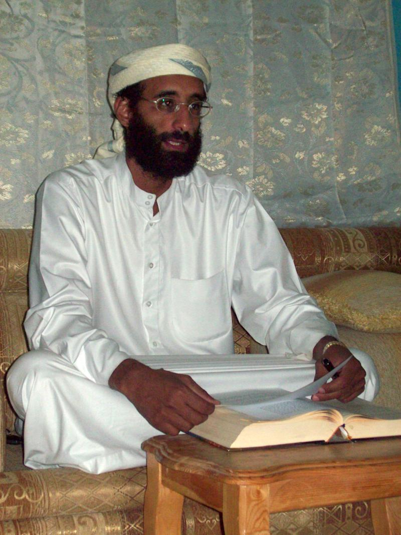 FILE - This Oct. 2008 file photo by Muhammad ud-Deen shows Imam Anwar al-Awlaki in Yemen. A Justice Department document says it is legal for the government to kill U.S. citizens abroad if it believes they are senior al-Qaida leaders continually engaged in operations aimed at killing Americans. (AP Photo/Muhammad ud-Deen, File)   ** MANDATORY CREDIT  NO SALES **