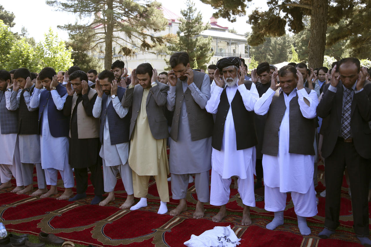 Afghan men attend Eid al-Fitr prayers at the presidential palace in Kabul, Afghanistan, Tuesday, June 4, 2019. Eid al-Fitr prayer marks the end of the holy fasting month of Ramadan in Afghanistan. (AP Photo/Rahmat Gul)