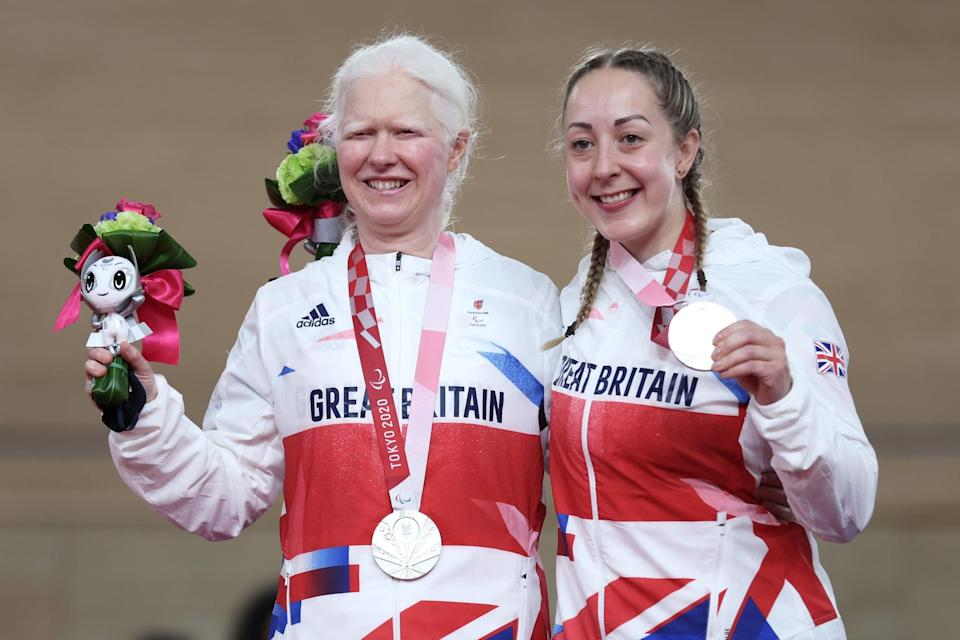 IZU, JAPAN - AUGUST 26: Silver medalists Aileen McGlynn (L) and pilot Helen Scott of Team Great Britain celebrate on the podium during the medal ceremony for the Track Cycling Women's B 1000m Time Trial on day 2 of the Tokyo 2020 Paralympic Games at Izu Velodrome on August 26, 2021 in Izu, Shizuoka, Japan. (Photo by Kiyoshi Ota/Getty Images)