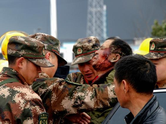 Paramilitary police officers transfer injured man after explosion (AFP/Getty Images)
