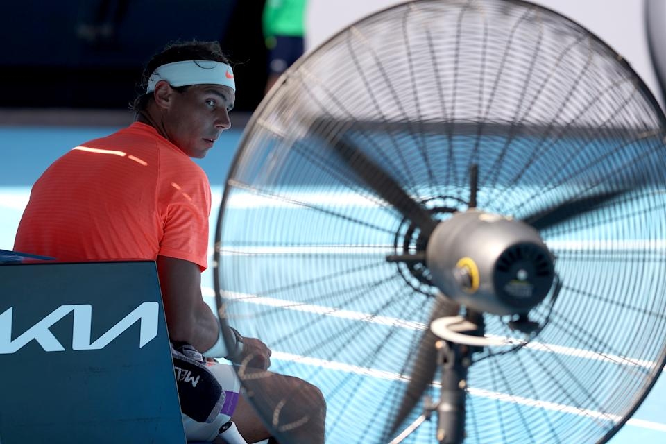 Spain's Rafael Nadal takes rest in front of a pedestal fan between the games against Italy's Fabio Fognini during their men's singles match on day eight of the Australian Open tennis tournament in Melbourne on February 15, 2021. (Photo by DAVID GRAY / AFP) / -- IMAGE RESTRICTED TO EDITORIAL USE - STRICTLY NO COMMERCIAL USE -- (Photo by DAVID GRAY/AFP via Getty Images)