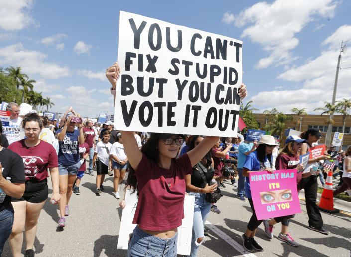 """Protesters take part in a """"March for Our Lives"""" rally in Parkland, Fla., last March. (Photo: Joe Skipper/AP)"""