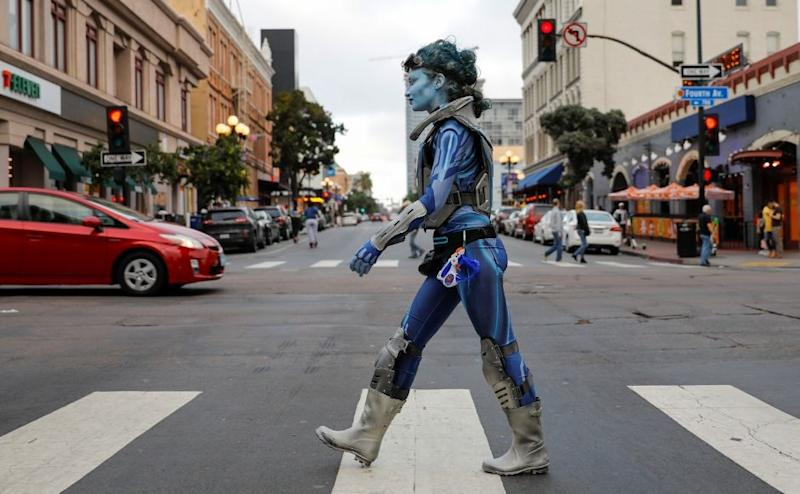 A woman walks across the downtown intersection on the evening of Day 1 of the Comic-Con in San Diego. Reuters/ Mike Blake