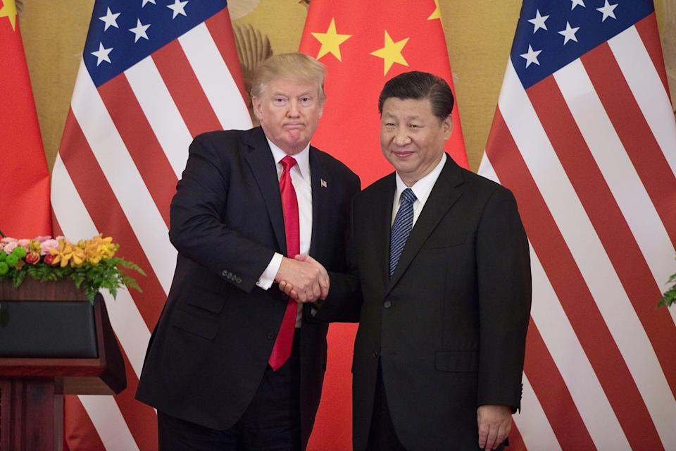 """US President Donald Trump (L) shakes hands with China's President Xi Jinping during a press conference at the Great Hall of the People in Beijing on November 9, 2017.  Donald Trump urged Chinese leader Xi Jinping to work """"hard"""" and act fast to help resolve the North Korean nuclear crisis, during their meeting in Beijing Thursday, warning that """"time is quickly running out"""". / AFP PHOTO / Nicolas ASFOURI        (Photo credit should read NICOLAS ASFOURI/AFP/Getty Images)"""