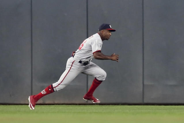 Washington Nationals center fielder Victor Robles gives chase on a single by Minnesota Twins' Willians Astudillo which broke up a no-hitter by Anibal Sanchez in the fifth inning of a baseball game Tuesday, Sept. 10, 2019, in Minneapolis. (AP Photo/Jim Mone)