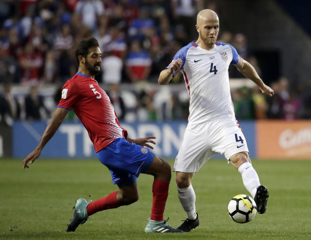 FILE - In this Sept. 1, 2017, file photo, U.S. midfielder Michael Bradley, right, and Costa Rica midfielder Celso Borges compete for the ball during the first half of a World Cup qualifying soccer match in Harrison, N.J. Bradley was called for the team's first training camp under coach Gregg Berhalter. But goalkeeper Brad Guzan and Jozy Altidore were omitted from a 27-man roster picked exclusively from players in Major League Soccer. (AP Photo/Julio Cortez, FIle)