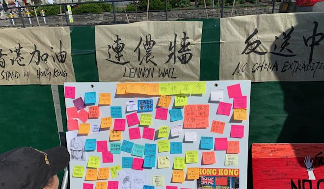 "Organisers set up a ""Lennon wall"" to express support for Hong Kong. Photo: Jodi Xu Klein"