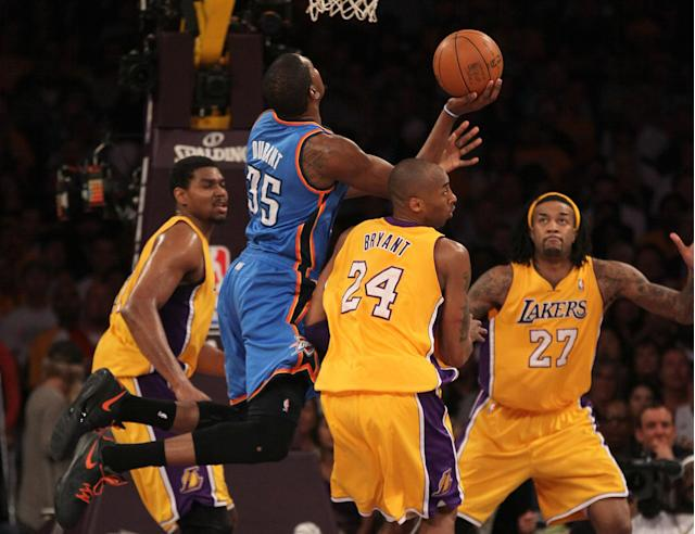 LOS ANGELES, CA - MAY 19: Kevin Durant #35 of the Oklahoma City Thunder goes up for a shot against Kobe Bryant #24 of the Los Angeles Lakers in the first quarter in Game Four of the Western Conference Semifinals in the 2012 NBA Playoffs on May 19 at Staples Center in Los Angeles, California. NOTE TO USER: User expressly acknowledges and agrees that, by downloading and or using this photograph, User is consenting to the terms and conditions of the Getty Images License Agreement. (Photo by Stephen Dunn/Getty Images)