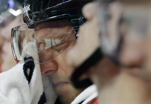 Chicago Blackhawks' Marian Hossa (81) wipes his face during the second period of an NHL hockey game against the St. Louis Blues in Chicago, Thursday, Oct. 17, 2013. (AP Photo/Nam Y. Huh)