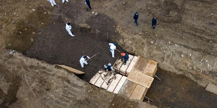 Drone pictures show bodies being buried on Hart Island in New York City, US, April 9, 2020.