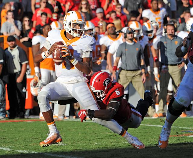 "ATHENS, GA – OCTOBER 1: <a class=""link rapid-noclick-resp"" href=""/nfl/players/30248/"" data-ylk=""slk:Joshua Dobbs"">Joshua Dobbs</a> #11 of the <a class=""link rapid-noclick-resp"" href=""/ncaab/teams/tag/"" data-ylk=""slk:Tennessee Volunteers"">Tennessee Volunteers</a> is sacked by <a class=""link rapid-noclick-resp"" href=""/ncaaf/players/252681/"" data-ylk=""slk:Natrez Patrick"">Natrez Patrick</a> #6 of the <a class=""link rapid-noclick-resp"" href=""/ncaab/teams/gaf/"" data-ylk=""slk:Georgia Bulldogs"">Georgia Bulldogs</a> at Sanford Stadium on October 1, 2016 in Athens, Georgia. (Photo by Scott Cunningham/Getty Images)"