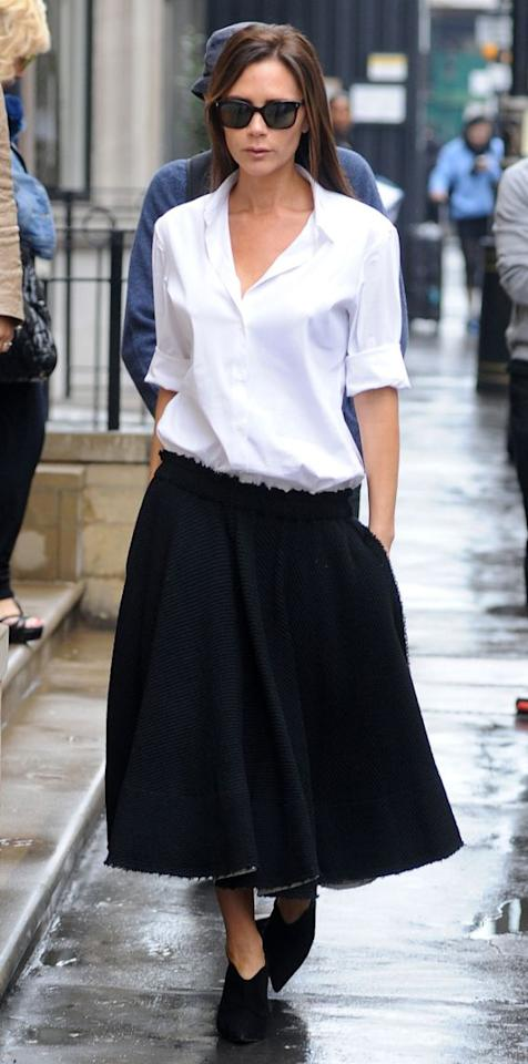 <p>You can never go wrong with a black and white combination, ever. Take a white shirt that is a size bigger than your actual one and team it up with a tailored skirt, just like Victoria Beckham. Wear your highest heels to look super chic and feminine. </p>