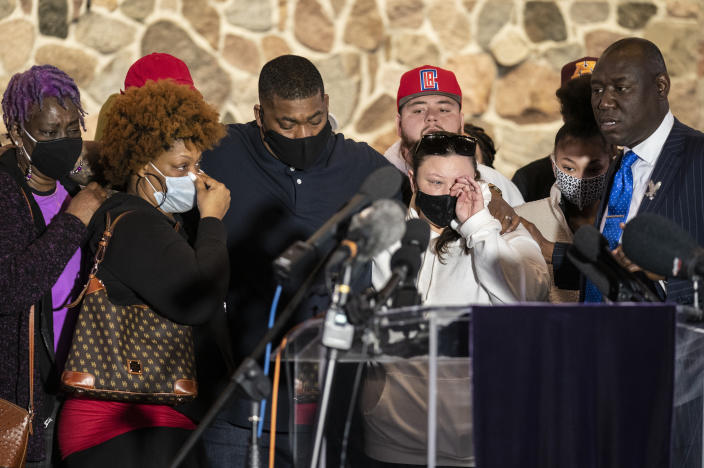 Family members of the deceased Daunte Wright, from left, Angie Golson, grandmother, Naisha Wright, aunt, Aubrey Wright, father, Katie Wright, mother, and the family's attorney Ben Crump, right, attend a news conference at New Salem Missionary Baptist Church, Thursday, April 15, 2021, in Minneapolis. (AP Photo/John Minchillo)