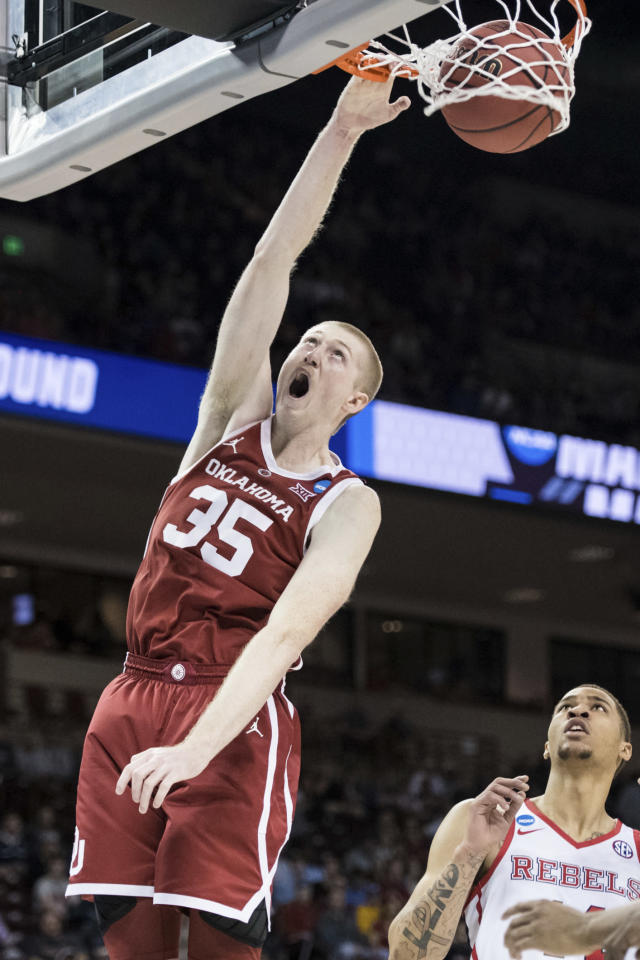 <p>Oklahoma forward Brady Manek (35) dunks the ball as Mississippi forward KJ Buffen, right, looks on during a first round men's college basketball game in the NCAA Tournament Friday, March 22, 2019, in Columbia, S.C. (AP Photo/Sean Rayford) </p>