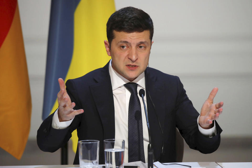 Ukraine's President Volodymyr Zelenskiy, speaks during a joint press conference with German Chancellor Angela Merkel, French President Emmanuel Macron and Russian President Vladimir Putin at the Elysee Palace in Paris, Monday Dec. 9, 2019. Russian President Vladimir Putin and Ukrainian President Volodymyr Zelenskiy met for the first time Monday at a summit in Paris to try to end five years of war between Ukrainian troops and Russian-backed separatists. (Charles Platiau/Pool via AP)