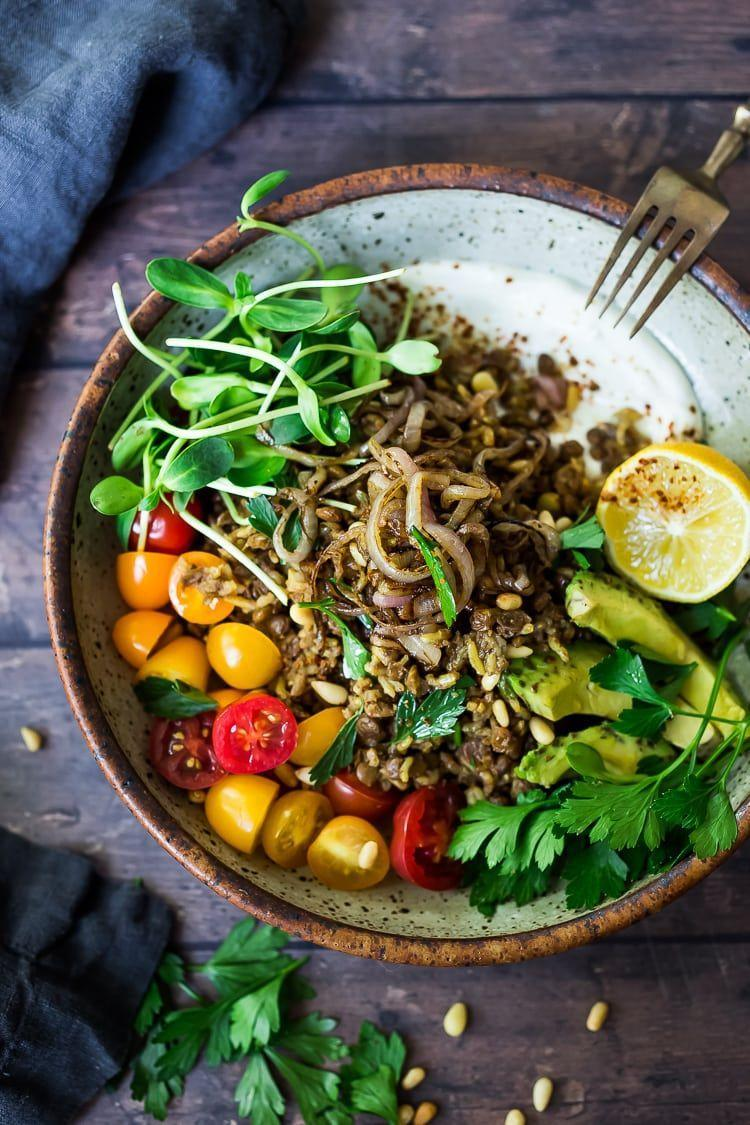 """<p>Mujadara is a Moroccan dish made up of lentils, rice and flavorful spices. It's an extremely affordable vegan comfort meal. Top with caramelized onions for zest and—on the side—slice up some fresh seasonal veggies to cool the palate.</p><p><em><a href=""""https://www.feastingathome.com/instant-pot-mujadara/"""" rel=""""nofollow noopener"""" target=""""_blank"""" data-ylk=""""slk:Get the recipe from Feasting at Home »"""" class=""""link rapid-noclick-resp"""">Get the recipe from Feasting at Home »</a></em></p>"""
